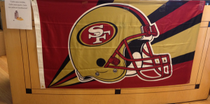 SF 49ers flag on display at the CitiScape front desk!
